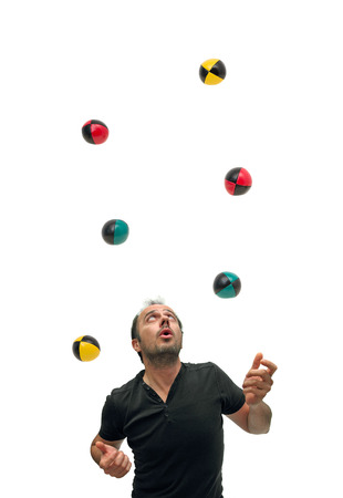 Juggling with six balls Standard-Bild