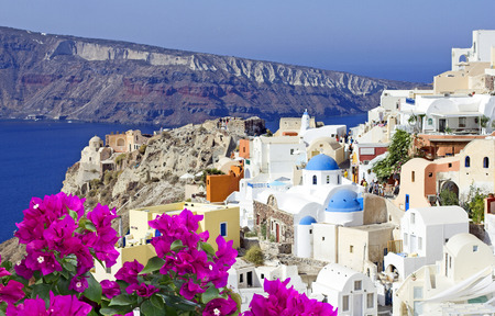 landscape flowers: View of Oia the most beautiful village of Santorini island in Greece.