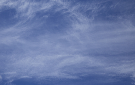 Blue sky with smoky clouds Stock Photo