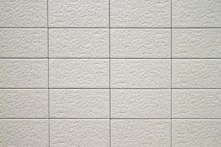 cemento: blanco la pared de fondo con el concepto de textura de piedra