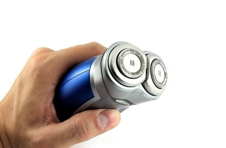electric shaver: rasoio elettrico tenendo a portata di mano isolati con sfondo bianco
