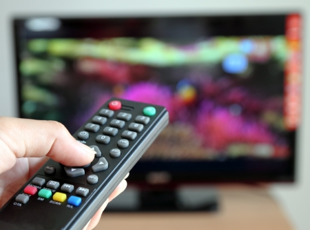 Hand pointing a tv remote control towards the television Stock Photo - 11151890