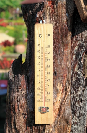 Thermometer on the wooden and high temperatures Banco de Imagens