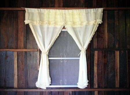 white drape and old wooden window photo