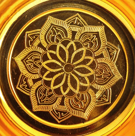 lotus pattern on gold tray of buddha photo