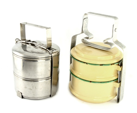 Metal and silver tiffin, food container on white background photo