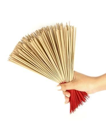 hand holding incense on white background photo