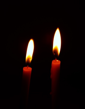 memory loss: burning candle on black background