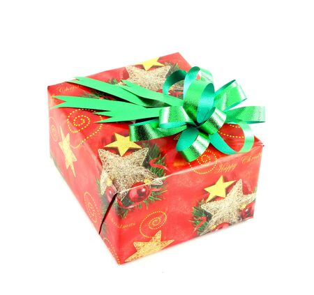 Christmas gift box with green bow isolated on white background photo