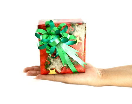 hand and gift over white background photo