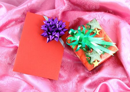 gift box and card on pink satin photo