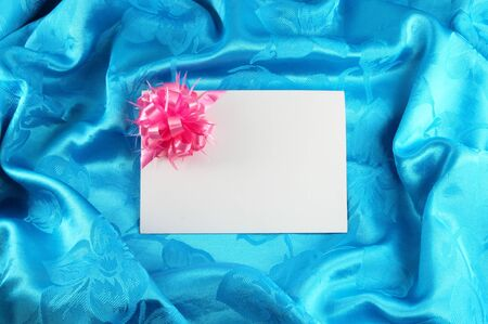 gift card with ribbon on blue satin Stock Photo - 11535495