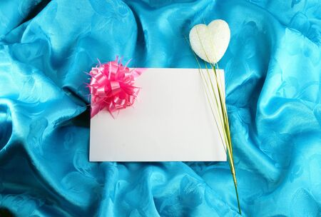 gift card with ribbon on blue satin Stock Photo - 11535522