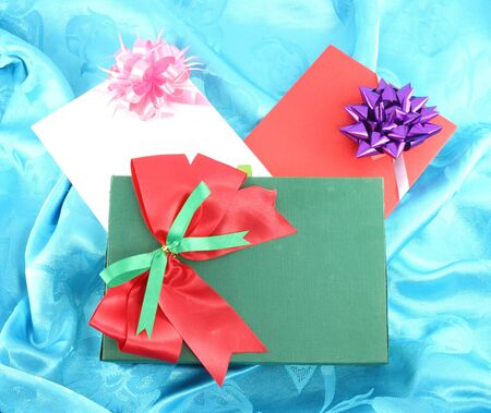 gift box and card on blue satin photo