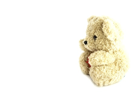 teddy bear toy with heart on white background photo