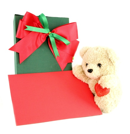 Teddy bear and card and gift on white background photo