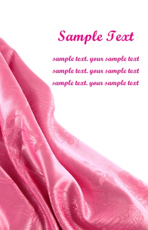 pink satin fabric with beautiful patterns of folds photo