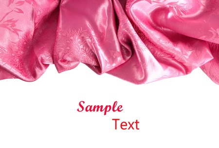Pink satin fabric against white background Stock Photo - 11535546