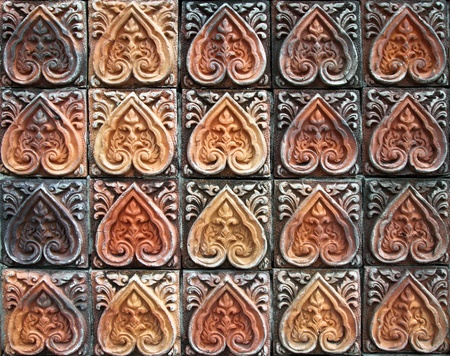 ancient decorative tiles in the east, Thailand photo