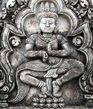 future buddha: Texture background surface brick brown wall buddha statue