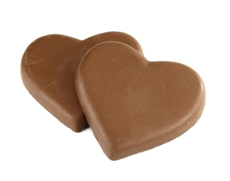chocolate heart shape on white background photo