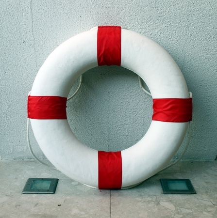 Lifebuoy inside the wall photo