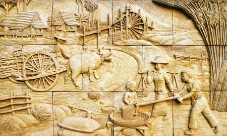 native culture Thai stucco on the stone wall, Thailand photo