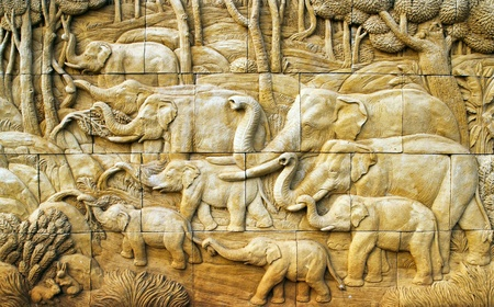 carved Elephant on stone wall photo