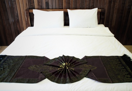 Beautiful double bed in traditional Thai setting photo