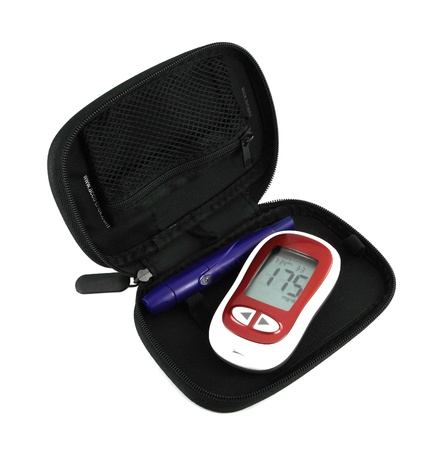 Diabetic Glucometer Blood sugar or glucose level testing kit isolated on a white background photo