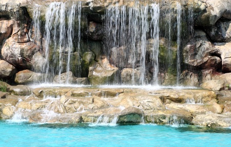 flowing waterfall in swimming pool Stock Photo