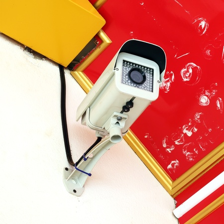 Security surveillance camera on the wall Stock Photo - 12887864