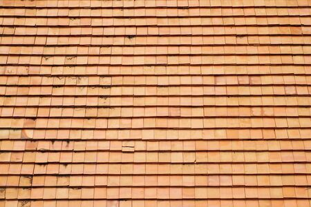 The Clay Roof Tiles of a House in the Countryside of Thailand photo