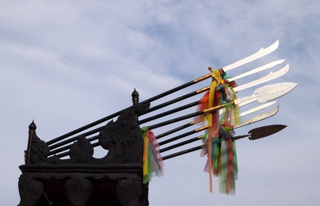 ancient weapon of the  King (THAILAND) on sky blackground photo