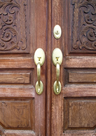 Door handles with an old double door photo
