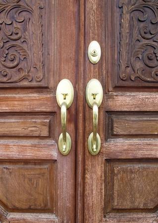Door handles with an old double door Stock Photo - 13130419
