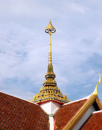 Tiered on temple roof with blue sky background photo