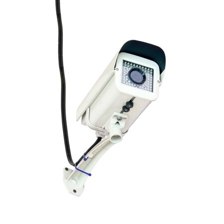 Security surveillance camera on white background photo