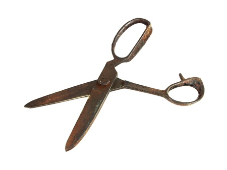 Old rusty sewing scissors isolated on white photo