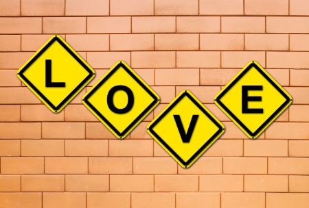 love sign on brick wall  background photo