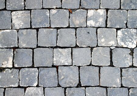 Old cobblestone road. Abstract background. Close up. photo