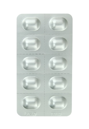 Pills in a blister pack on a white background photo