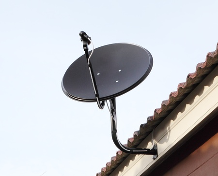 Black satellite antenna dish on the roof