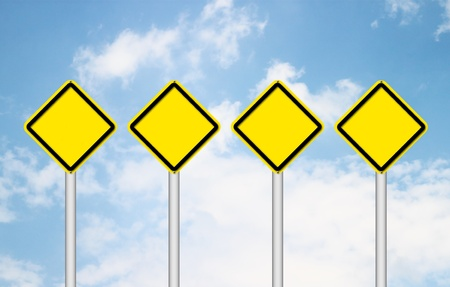 Four blank yellow traffic sign with blue sky Stock Photo - 14236288