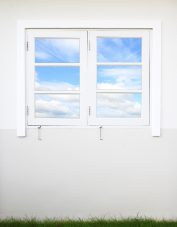 look inside: white window and wall with sky Stock Photo