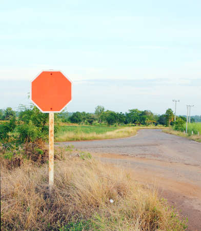 red blank sign in a country road photo