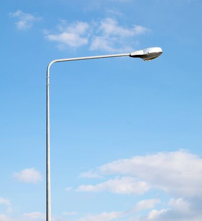 lamp post electricity industry with blue sky photo