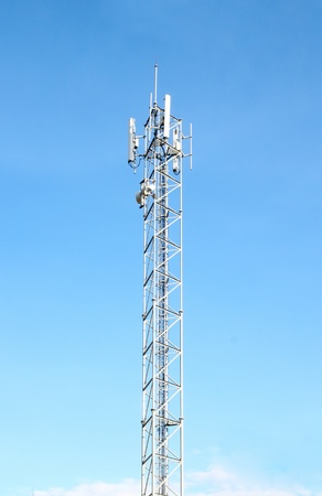 mobile telecommunication tower with blue sky background photo