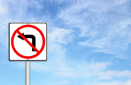 turn left sign: Road sign dont turn left over blue sky blank for text Stock Photo