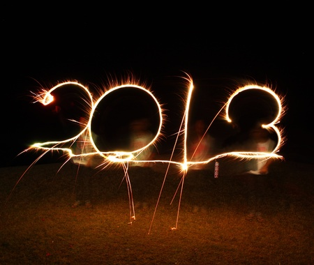 the boy write 2013 new year (fires) Stock Photo - 14660676